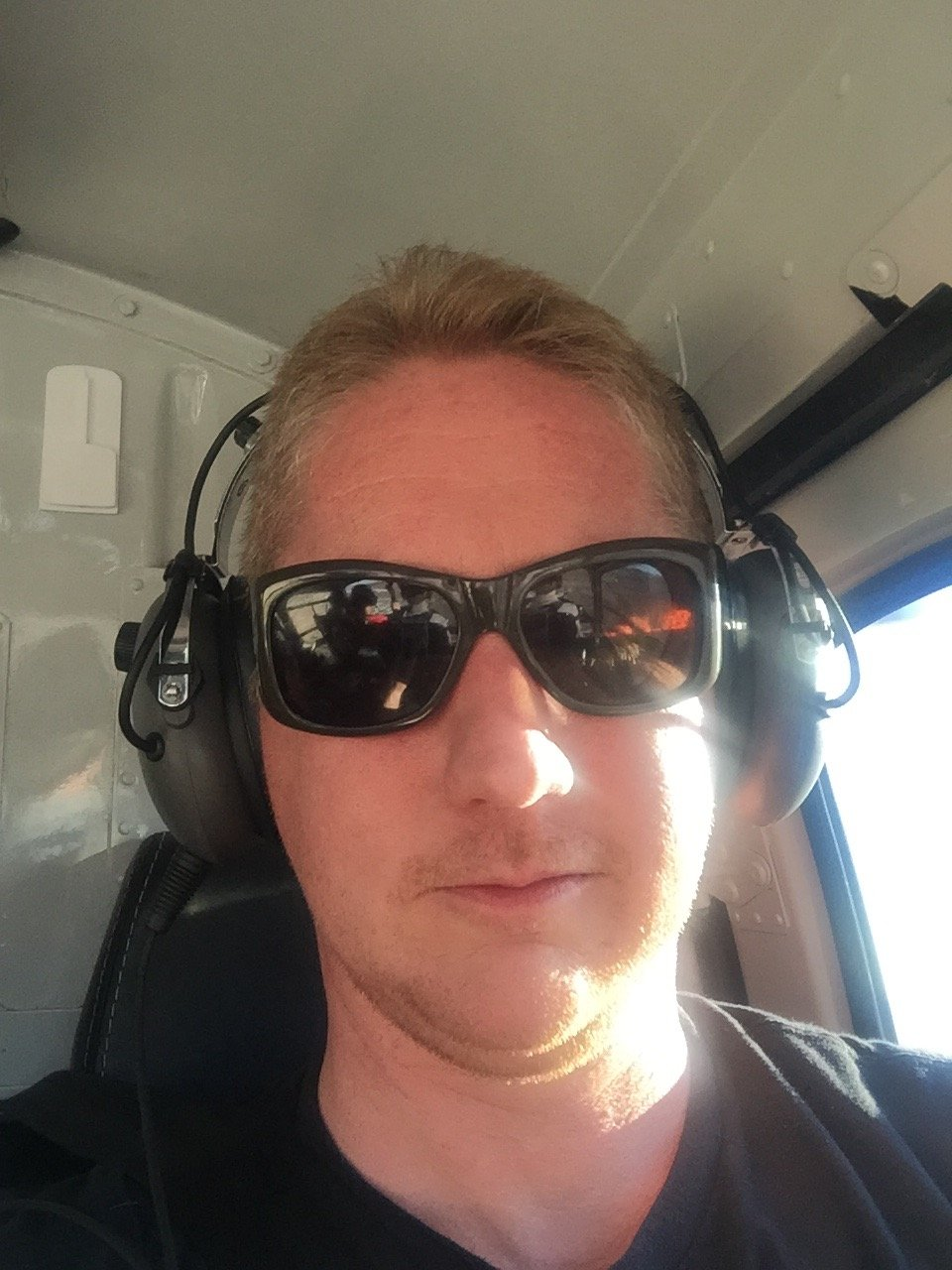 man with a van Edinburgh wearing sunglasses taking a selfie