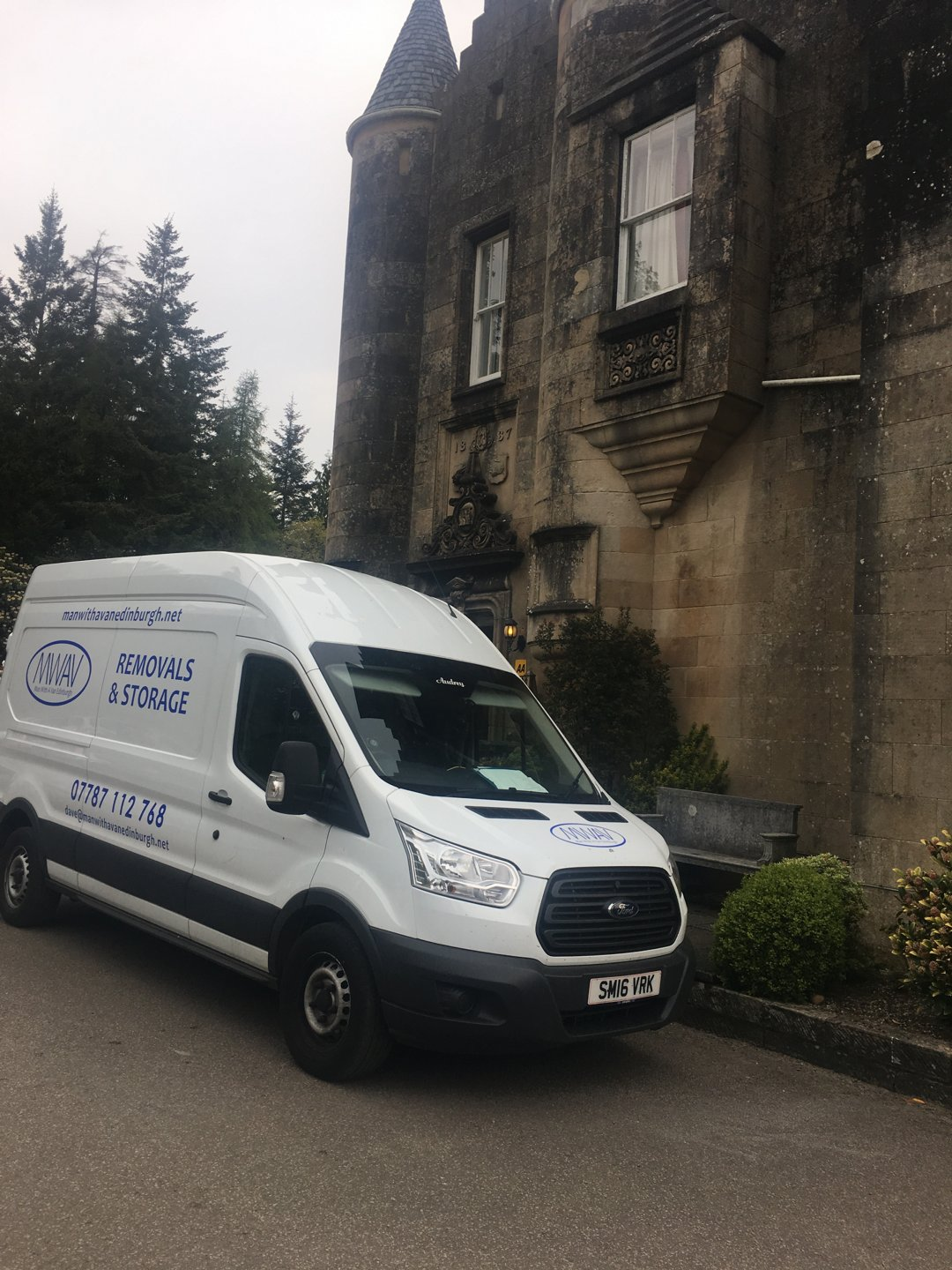 man with a van Edinburgh parked by the side of a building