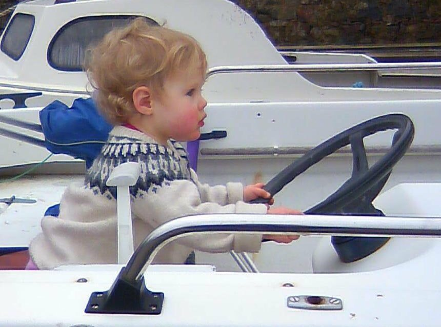 a small child sitting in a boat
