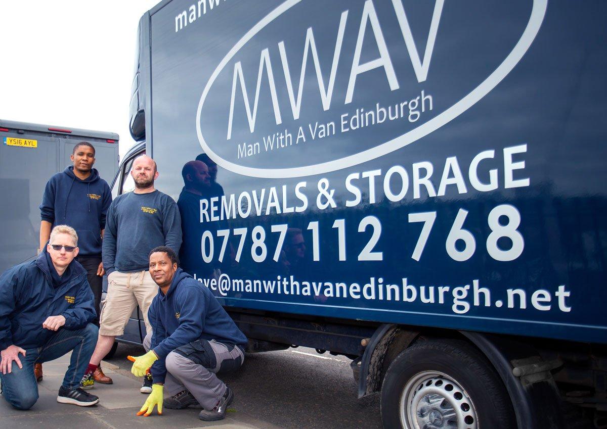 man with a van Edinburgh staff standing in front of blue van