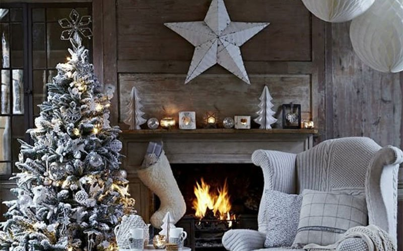 a fire place sitting in front of a fireplace
